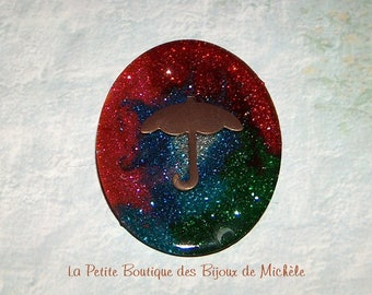 Cabochon resin, glitter and umbrella brooch