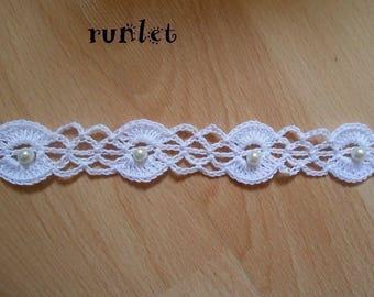 White cotton crochet lace collar around the neck