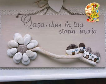 """Wooden plaque """"the beginning of a love affair"""" with painted rocks. The colors are shabby for a home style"""