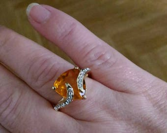 ring the divine in plated gold and orange cz stone