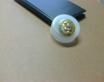 "Round gold button with embossed ""OR5"" glass bead"