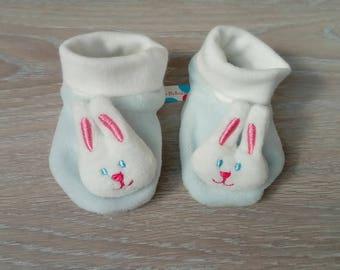 Pair of small baby rabbits representative botons