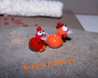 Couple of little chicks glass coral and orange seated