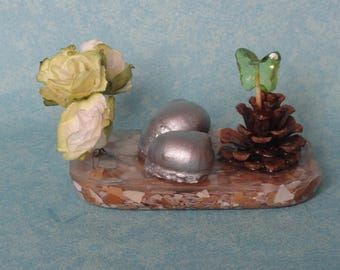 decorative pink resin, snails and Pine Cone
