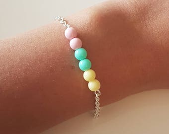 Pastel beads and silver bracelet