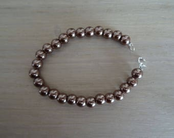 Bracelet has Brown Pearly beads