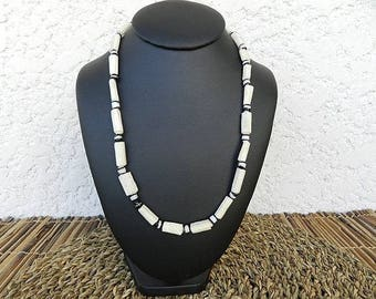 African necklace made of bone, Horn and black and white glass beads