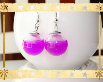Violet purple liquid filled glass globe mounted on silver plated