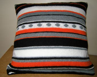 Cushion knitted in stripes and circles, grey, white, black and orange colors, closed by pressure, gift for her, gift for him