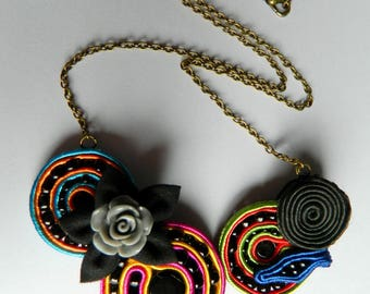 Necklace embroidered with soutache, beads and fabric flower