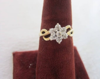 Solid 10 K Ladies Ring Yellow Gold with White Gold Star Flower set with 7 Tiny Diamonds