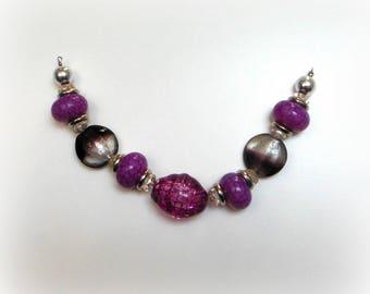 Set of beads in purple tones
