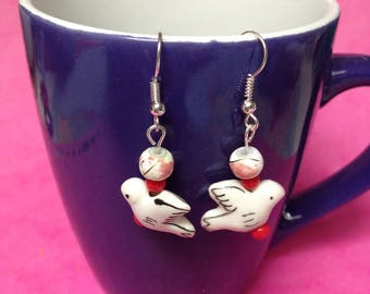 pair of porcelain bird and red beads earrings