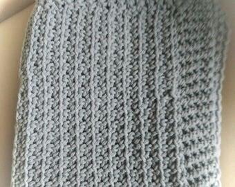 Crocheted grey baby blanket.