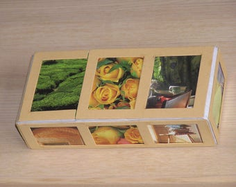 Cardboard box decorated with images on all sides