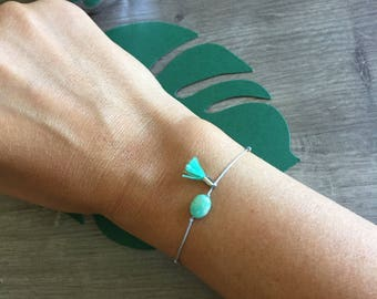 Mint green adjustable bracelet with bead and tassel