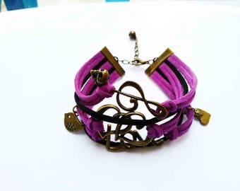 A beautiful black/deep purple bracelet and charms bronze