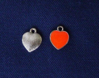 2 orange metal heart charms gold