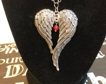 Angel wing necklace and wing with cross earring set