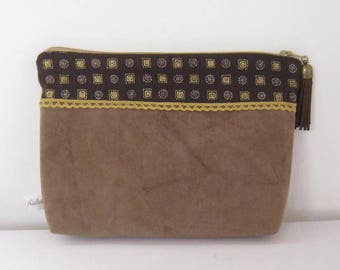 zippered taupe suede and fabric printed.