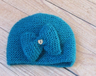 Hat with bow for baby from 6 to 12 months