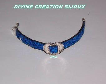 A glittery blue leather with a heart bracelet