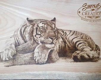 Tiger realaxing pyrography art