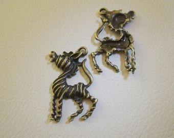 Set of two lovely charms in the shape of Zebra, one useful face, bronze, 4 x 3.3 cm
