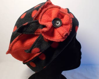 Hat hat in red and black fleece with red polka dots
