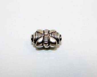 Rectangle 17 by 10 mm silver bead. streaked pattern.  Money first.