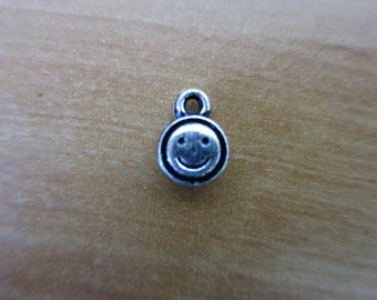 Silver smiley charm