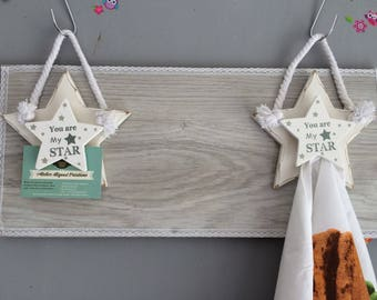 Wall decoration to hang towels or photos