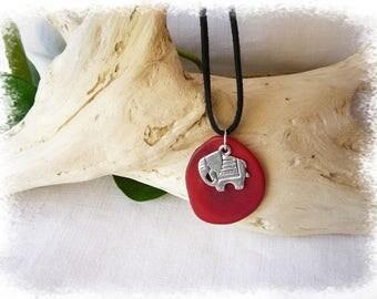 elephant on red vegetable ivory slice pendant