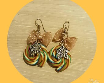 polymer clay earring and a bow