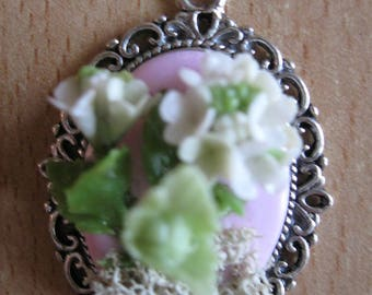 Pendant oval white hydrangea on a pale pink background