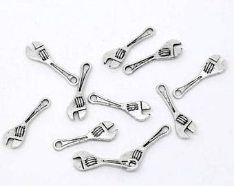 8 charms in silver metal wrenches