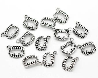 10 charms in silver vampire teeth