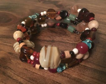 Variety of glass with various sized beads with turquoise laced in the stretch bracelet with no clasp
