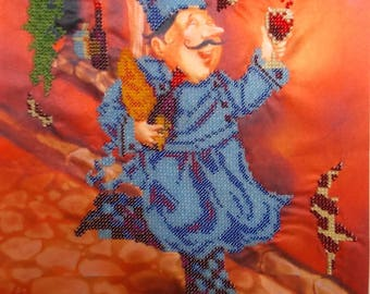 Painting canvas showing happy Cook embroidered glass beads