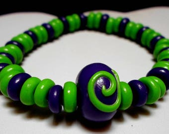 Polymer clay with spiral on elastic link bracelet