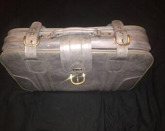 Akolite grey leather suitcase