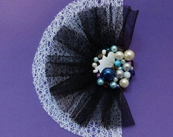 Fan-shaped brooch. Black tulle fabric White Bird and blue beads