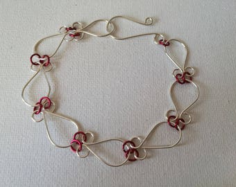 Inspirational jewellery gift, Sterling Silver handmade wire work bracelet, with red anodised Aluminium joining rings