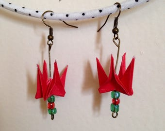 Red origami earrings. Red and green beads.