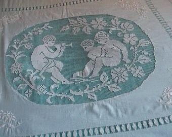 Sublime embroidered on old bed with cherubs