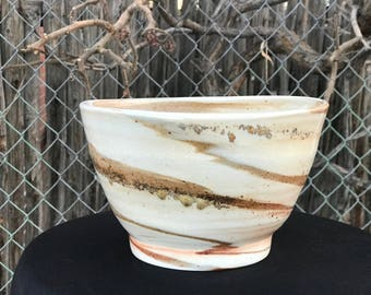 Hand made wheel thrown porcelain bowl with stoneware swirl.