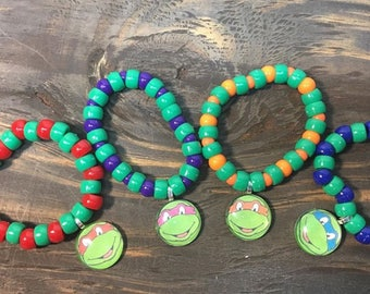 Teenage Mutant Ninja Turtles party favors.Ninja turtles bead bracelet .ninja turtles pendant necklace.kids Party favors .