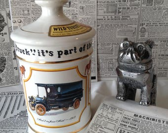 Vintage Mack Truck Hood ornament and Wild Turkey Decanter set