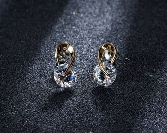 Gold plated Sellux cubic zirconia stud earings