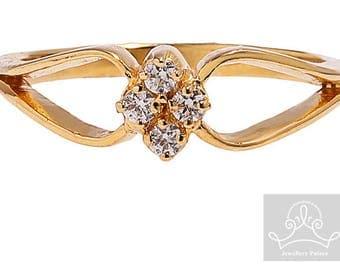 9ct yellow gold split shank four stone diamond ring